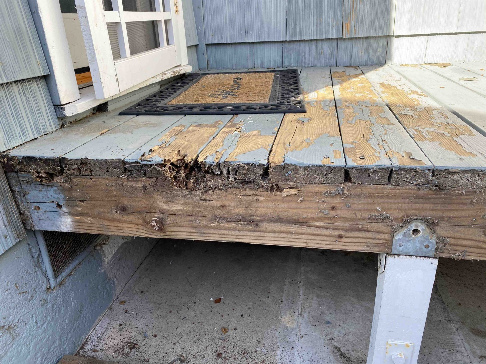 Visible termite infestation and water damage on side deck and staircase 1 1 scaled - Jewell Street